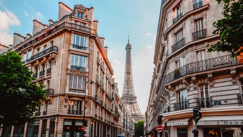 Different angle of view for the Eiffle Tower, taken from paris internal streets.   Shutterstock HD Video #1012293902