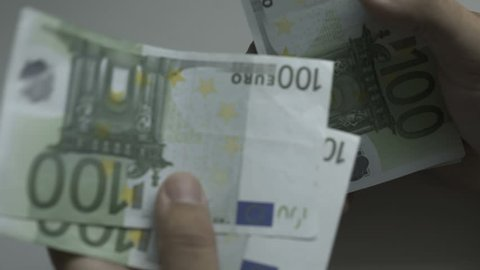 Counting money, Seamless loop video of male hands counting a lot of one hundred Euro bills