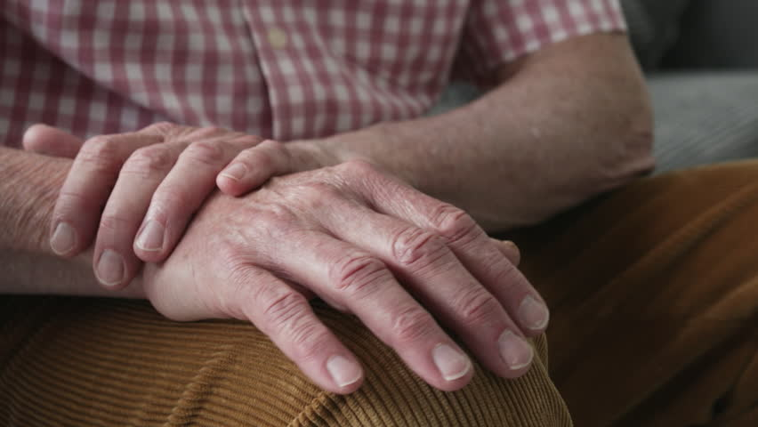 Man Suffering With Parkinsons Disease Holding Trembling Hand