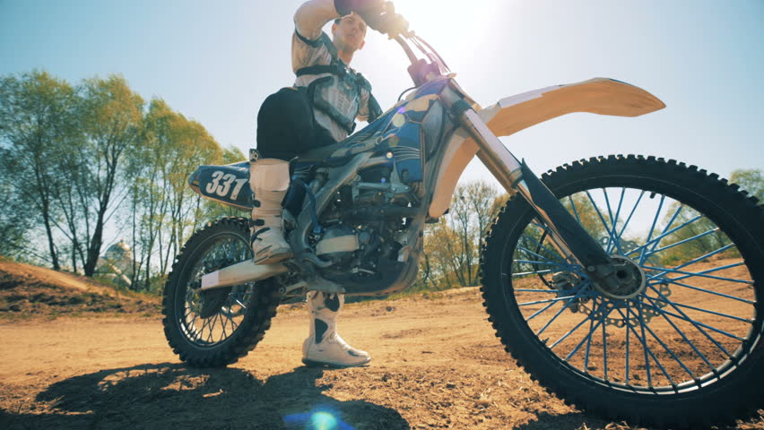 Motorcycle is getting prepared to moving by being taken off from brakes | Shutterstock HD Video #1012312517