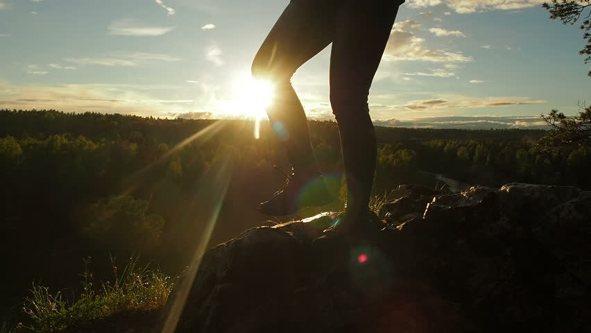 Hiking Boots Silhouette Walking Hiking Trail. Mountaineering boots female hiker climbing mountain peak, hiking on summer sunset. Travel concept Boots On Hiking Trail. Slow motion, close up.  | Shutterstock HD Video #1012326623