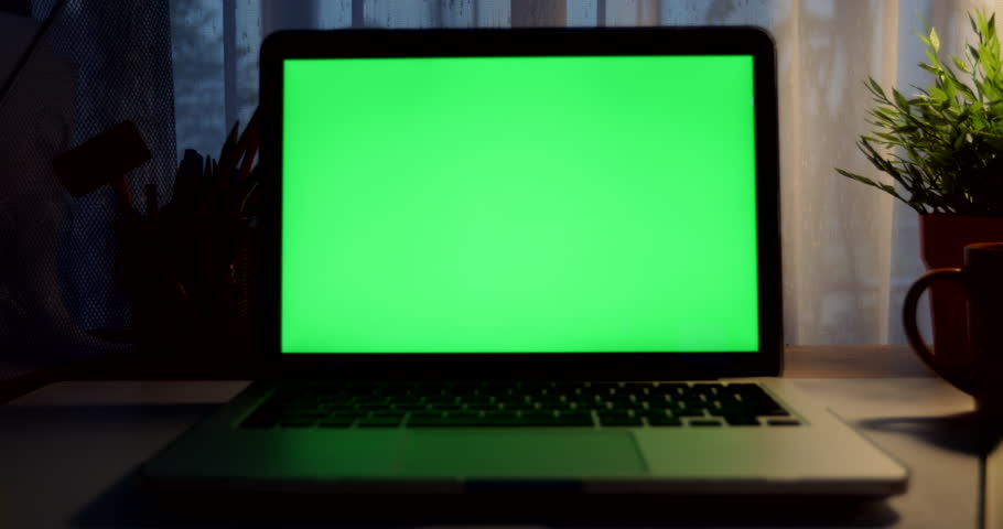 Laptop with green screen. Dark office. Dolly out. Perfect to put your own image or video.Green screen of technology being used. Chroma Key laptop | Shutterstock HD Video #1012335236