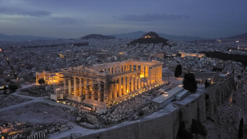 Athens Acropolis and Parthenon in evening in 4k drone shot. City center in background | Shutterstock HD Video #1012348373
