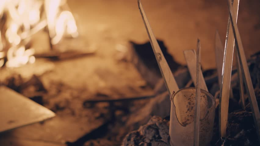 Young man feels cold and warms up himself by bonfire | Shutterstock HD Video #1012353986