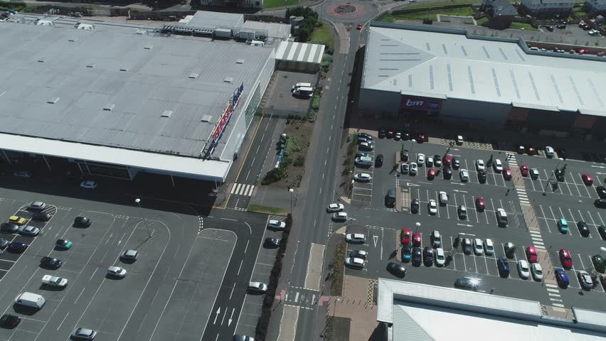 Port Glasgow, Scotland, UK; June 12th 2018: Aerial footage over the Tesco Extra store and car park at the retail park. #1012366367