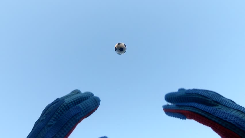 Soccer Goalkeeper Catches Football With Gloves, High Ball In Slow Motion. A Variety Of 4K Camera Angles Available.