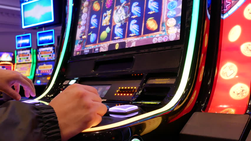 Coquitlam, BC, Canada - June 12, 2018 : Motion of people playing slot machine inside Casino with 4k resolution | Shutterstock HD Video #1012402034