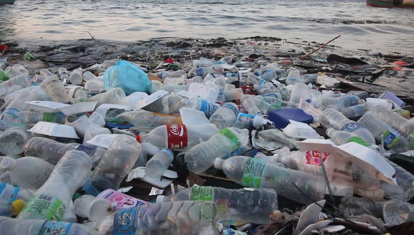 SEMPORNA, MALAYSIA - CIRCA MAY 2018: Plastic pollution environmental problem. Plastic bottles dumped in sea pollute ocean