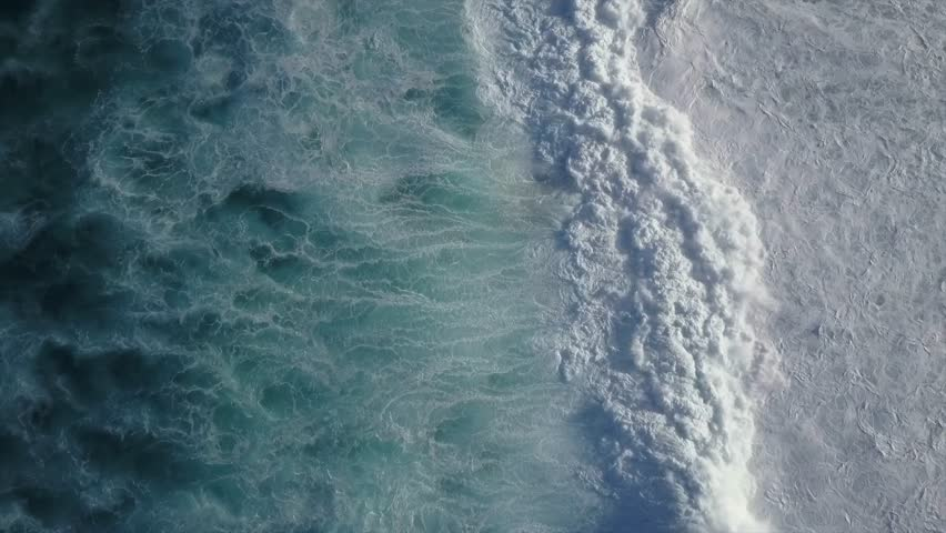 Big Waves rolling from above. Top down 4k drone view on blue turquoise ocean, breaking waves, whitewash. Sunny day over the sea. Huge swell hitting shoreline. Powerful waves Oahu, Hawaii North Shore #1012439774
