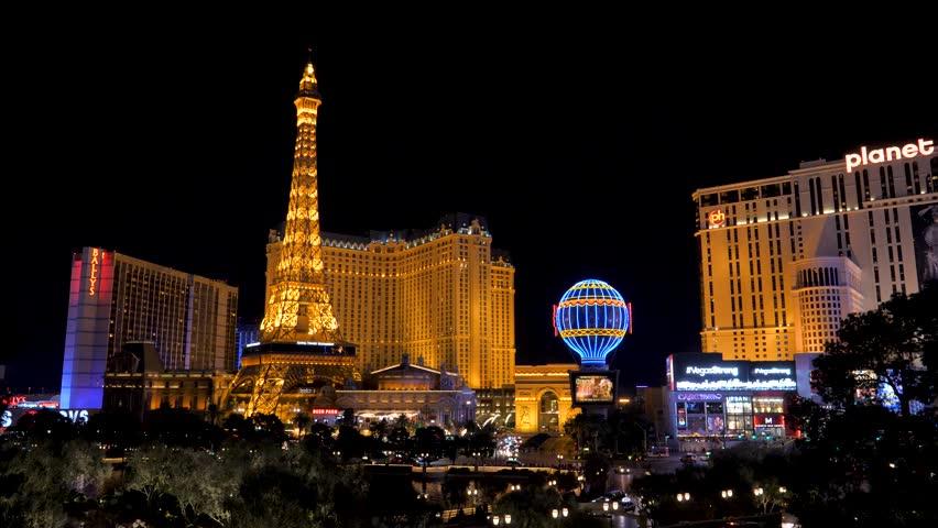 Las Vegas, USA-November 07,2017: View night neon illuminations of Las Vegas famous for Paris casino hotel, people walk around the city at night, cars drive on the roads, 4k, 3840x2160