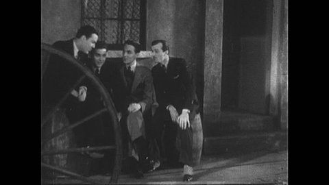 1930s: Barbershop quartet sings. Cowboy walks up quartet and speaks. Man speaks to cowboy.