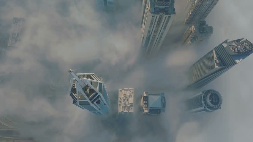 View from above on Dubai Marina in the fog. 4K video