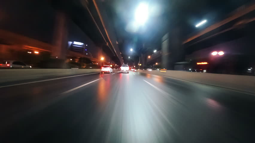 Time-lapse moving forward of road in city with bridge at night, thailand. | Shutterstock HD Video #1012534208