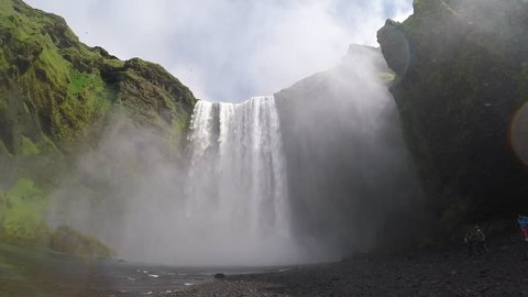 Amazing view of powerful Skogafoss waterfall. Location Skoga river, Iceland, Europe. Scenic footage of beautiful nature landscape. Discover beauty of earth. Full HD 1080 video. Slow motion 120 fps.