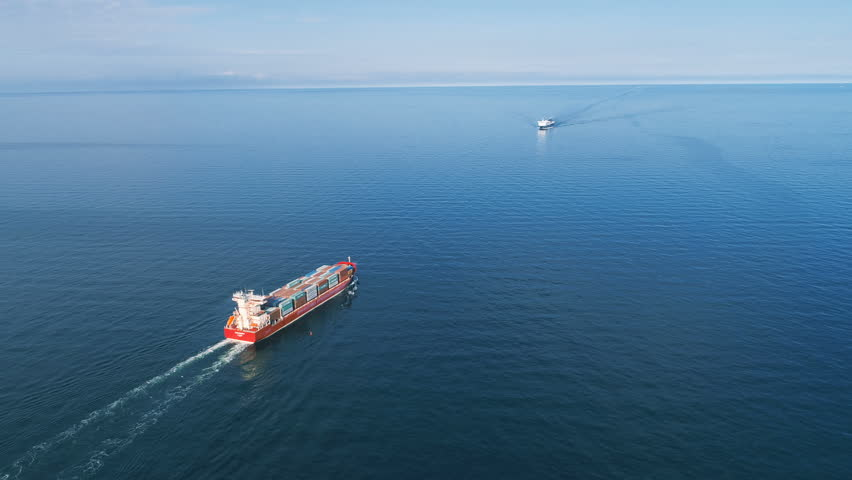 Aerial Timelapse of Container Ships Passing in the Sea