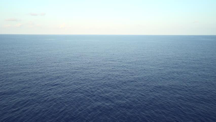 Aerial shot of open ocean. Flight over of open sea. | Shutterstock HD Video #1012548359