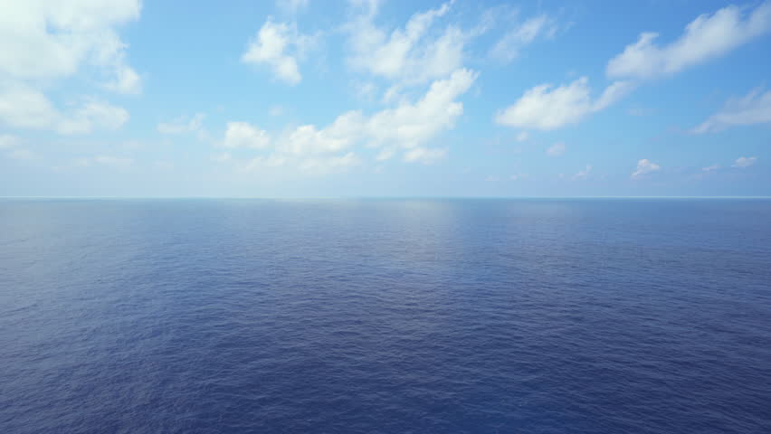 Aerial shot of open ocean. Flight over of open sea. | Shutterstock HD Video #1012548365