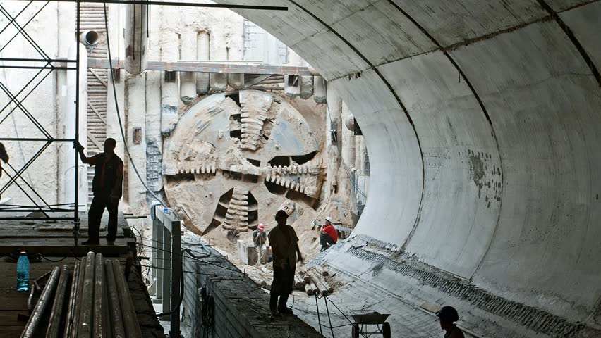 Tunnel boring machine moving across subway station under construction Royalty-Free Stock Footage #1012569515