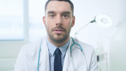 POV Professional Doctor Has Video Call with a Patient. Medical Professional Talking via Internet