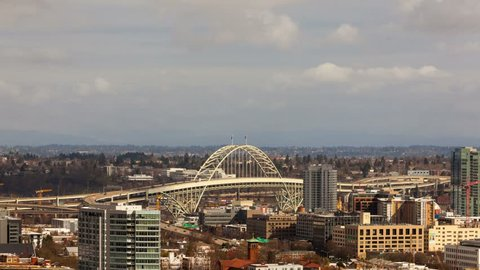 Time lapse movie of moving clouds and auto traffic in downtown city of Portland OR with Fremont Bridge 4k uhd