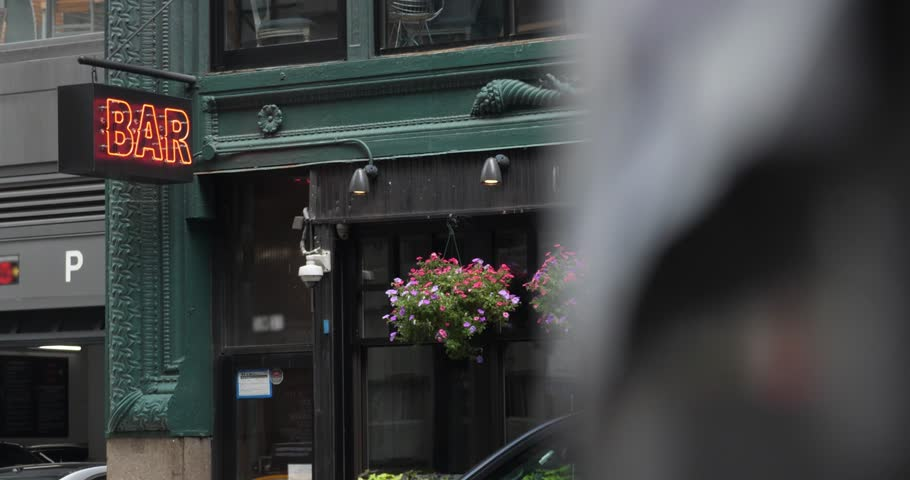 A daytime slow dolly reveal establishing shot of a typical downtown Manhattan bar, restaurant, or cafe.  Additional rights may be needed for commercial use. | Shutterstock HD Video #1012625060