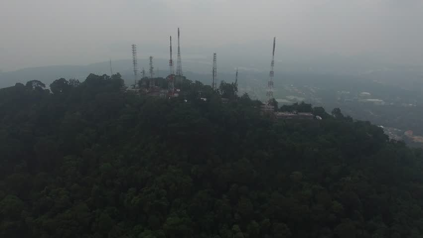 Pollution of smoked cloud from wild fire in Sumatra island Indonesia cover radio and television Station on the Mountain and all southern of Thailand. | Shutterstock HD Video #1012629536