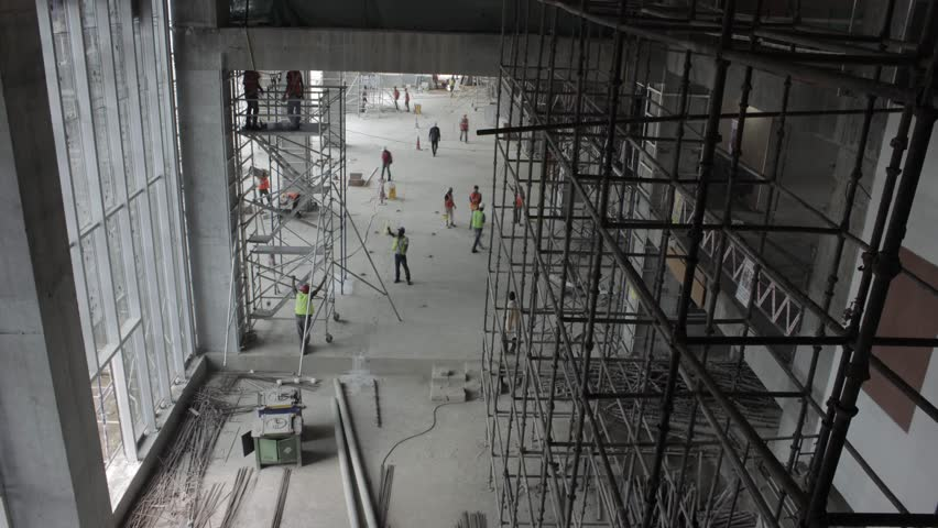 Building Interior Construction timelapse. Construction workers and supervisors working on an upcoming office building Bangalore India