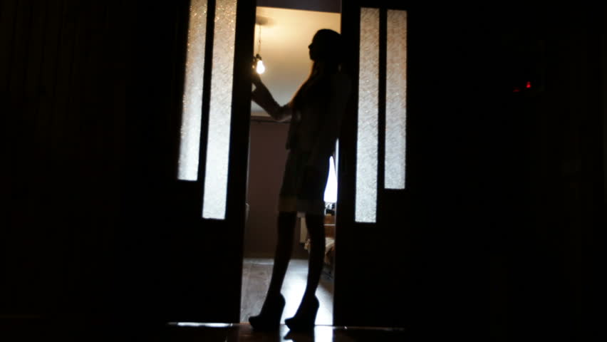 Blurred silhouette of a woman in the room in doorway in quarantine | Shutterstock HD Video #1012664447