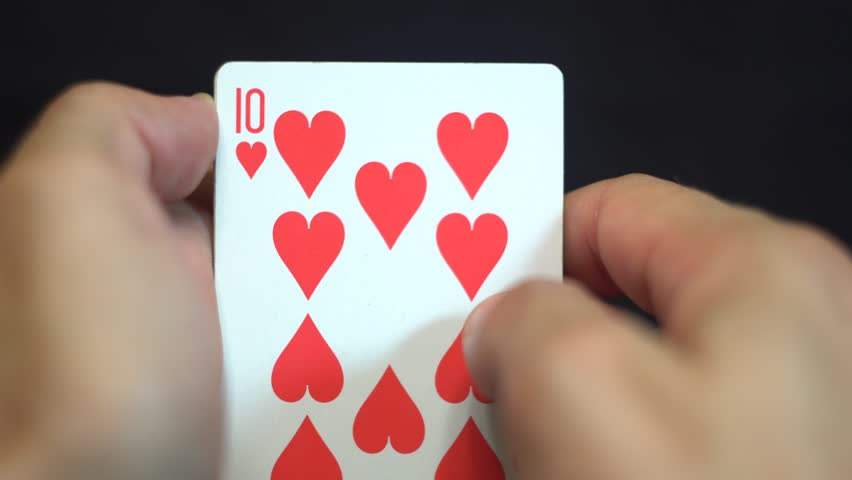 Royal Flush Hearts. Gambler player revealing royal straight flush card by card. Holding in his hands luckiest poker combination. Isolated object, black background, 4K