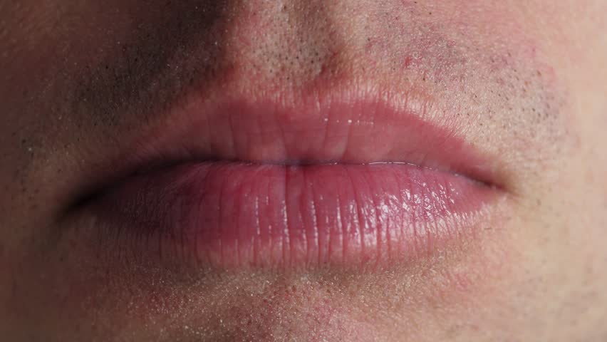 Man chewing gum. Closeup on mouth | Shutterstock HD Video #1012688438