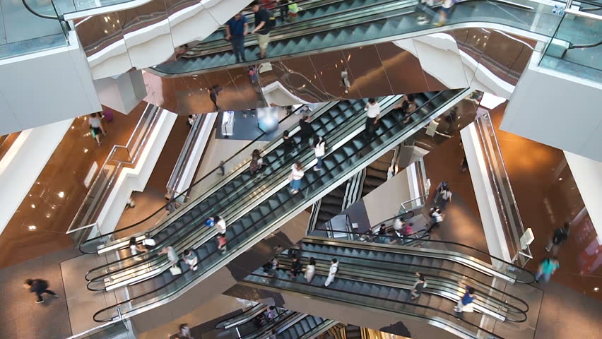 Time lapse escalators in modern shopping mall crowd of people. Very busy full of clients mall complex. Consumption concept | Shutterstock HD Video #1012688633