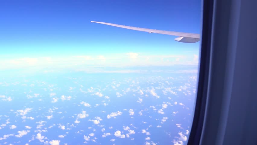 View from airplane window to the sky and plane wing, nobody #1012689083