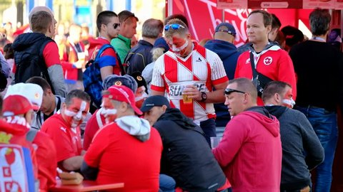 Kaliningrad - Russia, June 22, 2018: Football fans support teams on the street of the city on the day of the match between Serbia and Switzerland