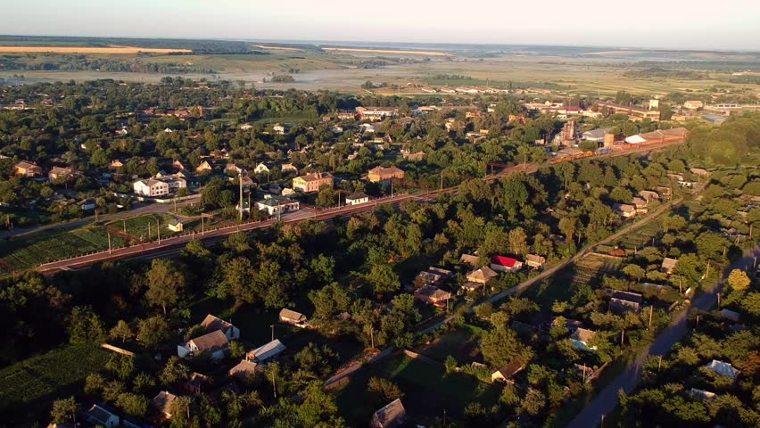 Aerial view on the village in warm summer light  | Shutterstock HD Video #1012704296