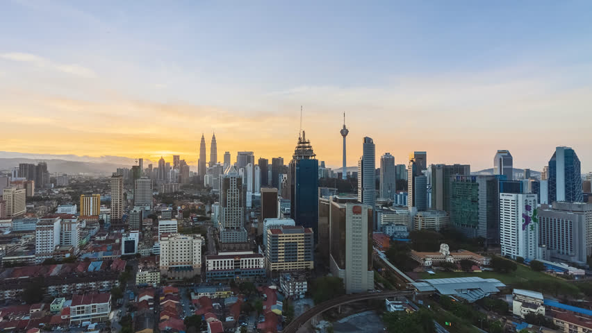 Time lapse: Beautiful Kuala Lumpur city view during dawn overlooking the city skyline from night to day. Full HD 1080p | Shutterstock HD Video #1012717106