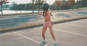 Funny happy young female dancer caucasian woman urban street dancing freestyle in the city. 4K video shooting by handheld gimbal