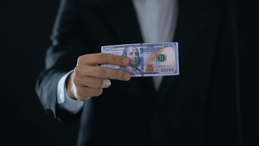 Male hands crumpling dollar banknote and throwing out, income decline, crisis | Shutterstock HD Video #1012751006