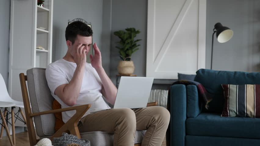 Headache, Tense Man Working on Project | Shutterstock HD Video #1012753610
