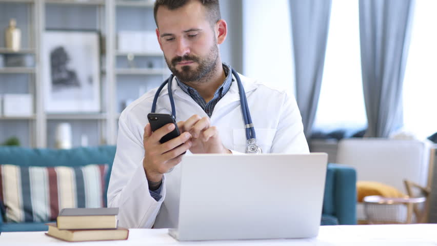 Doctor using  Phone