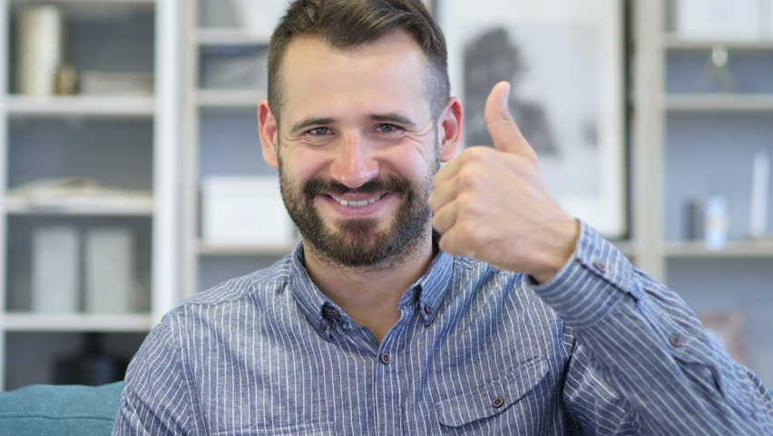Thumbs Up by Adult Man at Work, Looking at Camera | Shutterstock HD Video #1012754408