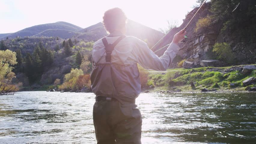 Man flyfishing in river in Utah | Shutterstock HD Video #1012763933