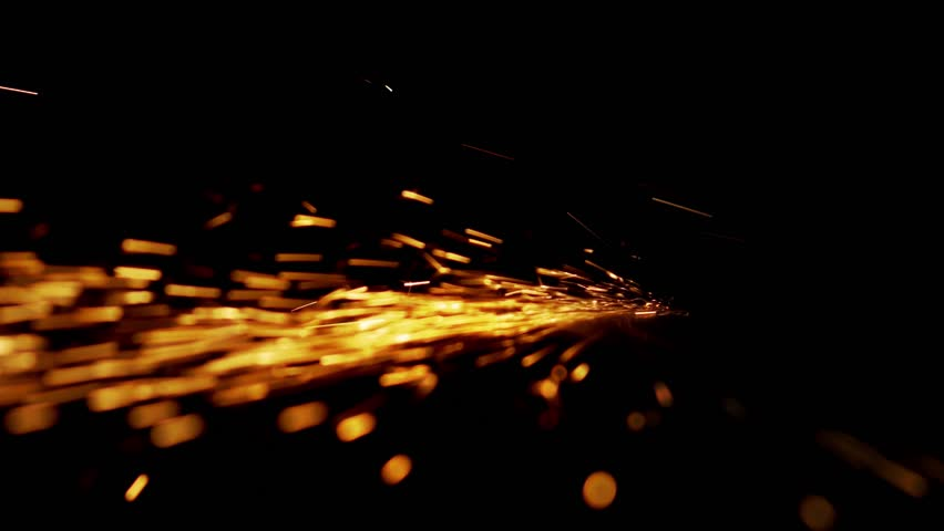 Horizontal bundle of glowing sparks on a black background | Shutterstock HD Video #1012799399