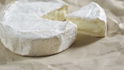 Portion of rotating creamy Camembert as detailed 4k footage