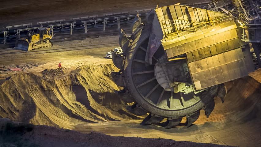 Bucket-wheel excavator in open-cast mining pit in Germany