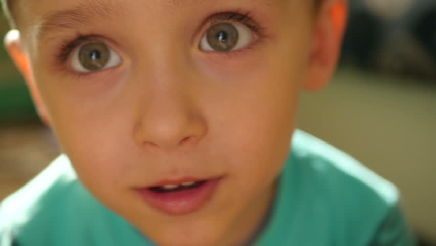 Close-up: the eyes and nose of the child at a slowed pace. The boy enjoys close-up   Shutterstock HD Video #1012802168