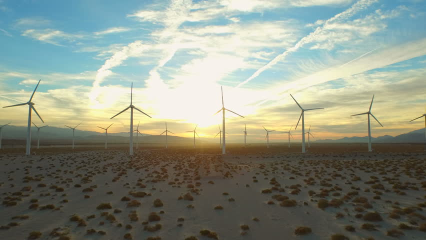 Wind Turbine Aerial v7 Flying low below large wind turbines at sunrise. #10128188