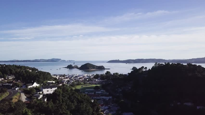 Beautiful bay of islands in New Zealand, aerial rise in the morning to show the beauty of the bay at Paihia. | Shutterstock HD Video #1012827422