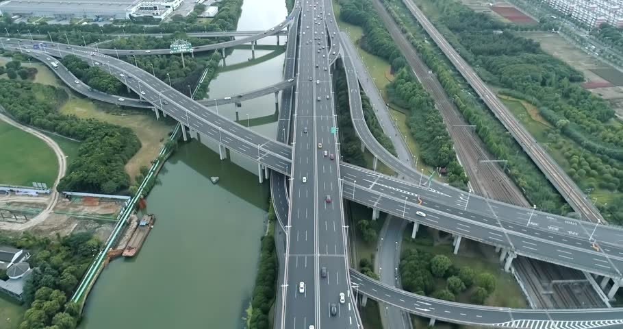 Aerial drone flight over evening road traffic. Two-level road junction. Top view. 4K | Shutterstock HD Video #1012828952