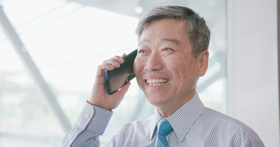 Old businessman smile happily and speak phone | Shutterstock HD Video #1012829063