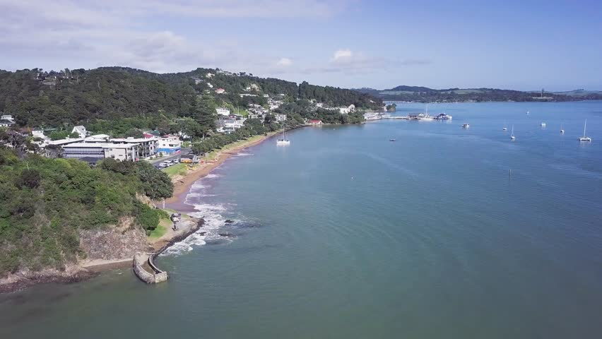 Aerial view of Paihia beach, in the beautiful New Zealand bay of islands. | Shutterstock HD Video #1012829117